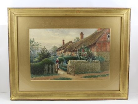 WILLIAM WELLS QUATREMAIN (1857-1930) Anne Hathaways Cottage, Shottery, Stratford-upon-Avon featuring a figure at the garden gate and hollyhocks, a Watercolour painting, signed, 31cm x 48cm, mounted in gilt glazed frame