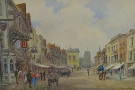 WILLIAM WELLS QUATREMAIN (1857-1930) High Street, Stratford-upon-Avon, looking towards the Town Hall and Guild Chapel, with W.H. Smith and Logins the chemist on the left, with figures, horses and carts, a Watercolour painting, signed, inscribed and dated 1924 verso, 25cm x 37.5cm, unframed