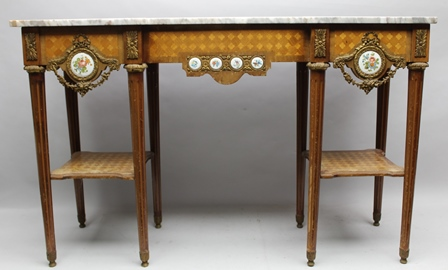 A CONTINENTAL FRENCH RESTORATION STYLE CONSOLE TABLE, having inverted breakfront with marble top, the frieze parquetry inlaid with various timbers, having gilt metal mounts and inset Sevres type floral porcelain plaques, raised on turned tapering supports, with side undertiers, 131.5cm wide x 40cm deep x 83cm high