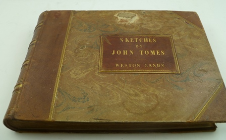 AN ALBUM OF 19TH CENTURY WATERCOLOUR PAINTINGS BY JOHN TOMES, predominantly landscapes, mounted on pages, some inscribed in pencil with titles (together with folder of correspondence), average size 21cm x 30cm, half calf bound with gilt tooled leather title Sketches by John Tomes, Weston Sands (85 painting in book)