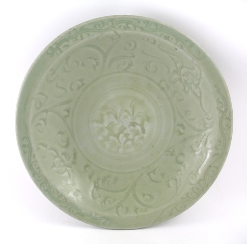 A CELADON BOWL decorated en scraffito with stylised leaves and scrolls, unmarked, 27cm diameter