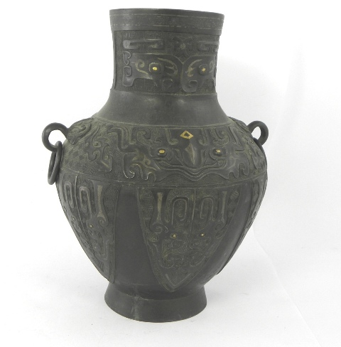 A 19TH CENTURY ORIENTAL BRONZE VASE cast with twin ring handles and various other forms, highlighted with gilt, 35cm high