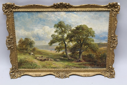 GEORGE TURNER (1843-1910) Near Blackwall, Derbyshire, depicting a landscape study with shepherd and sheep at rest, an Oil on canvas, signed Geo. Turner, inscribed verso and dated 1899, 50cm x 75cm in an ornate gilt frame