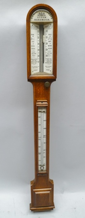 A NEGRETTI & ZAMBRA ADMIRAL FITZROYS STORM BAROMETER, the arched top grain painted, possibly beech framed, with glazed ceramic calibration panels, with thermometer to trunk, overall 102cm high