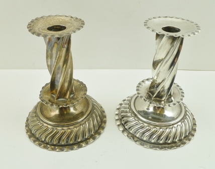A PAIR OF EARLY GEORGIAN DESIGN SILVER CANDLESTICKS with removable drip pans, on spiral columns, with domed, fluted and crimped bases, London 1887, 14cm high (ex The Sherlock Holmes Museum Collection, 221b Baker Street, London)