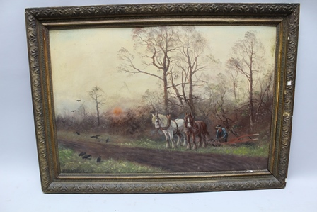 JAMES W. BROOK Adjusting the plough, horse drawn team, on the edge of woodland with crows in the foreground, an Oil on board, signed, 52cm x 77cm in ornate gilt frame