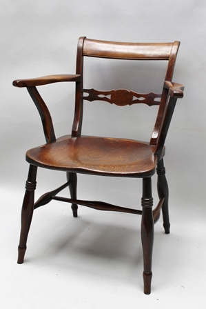 A 19TH CENTURY PROVINCIAL OPEN ARMCHAIR, ash and fruitwood with an elm seat (the back of the seat is stamped with the initials R.P.)