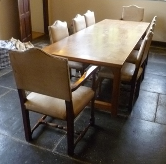 A 20TH CENTURY ARTS & CRAFTS DESIGN ELM REFECTORY TABLE, on squared supports with cross stretchers designed by Michael Reardon, (Architect and designer to the RSC) 96cm x 259cm (Please note set of 8 chairs not included, see lot 428)