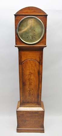 A REGENCY TIMEPIECE, MAHOGANY DOME TOP LONGCASE, with brass circular dial, having main minutes dial with two secondary dials for hours and seconds, regulatory type, 8-day movement, circa 1810