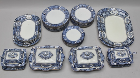 A WOOD & SONS KHOTAN PATTERNED BLUE & WHITE TRANSFER PRINTED DINNER SERVICE, comprising a pair of cushion form vegetable tureens with covers, pair of sauce tureens with covers, stands and ladles, 12 x 25cm diameter plates, 12 x 23cm diameter plates, and 12 x 19cm diameter plates, 4 x graduated meat dishes, largest 46cm x 33cm, and a pair of serving platters 28cm x 20cm