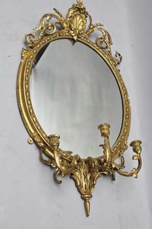 A 19TH CENTURY GILT GESSO FRAMED GIRONDELLE WALL MIRROR, fitted with three candle sconces to the base and a scallop crest with acanthus scrolls, overall height 106cm