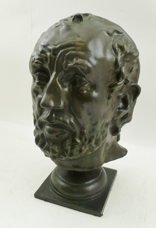 AFTER AUGUSTE RODIN A CAST BRONZE PORTRAIT HEAD, man with broken nose (seminal piece in his career), inscribed Rodin, on socle and square platform base, 30cm high
