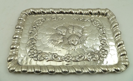 WILLIAM DEVENPORT AN EDWARDIAN SILVER TRAY, having embossed cherub masks within a floral wreath and decorative gallery, Birmingham 1904, 30cm x 21cm, 362g.