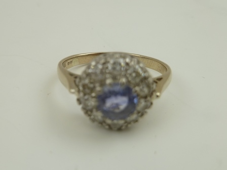 A TANZANITE AND DIAMOND CLUSTER RING, 18ct white gold mounted, size P and half