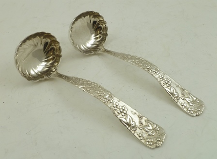 A PAIR OF TIFFANY STERLING SILVER SAUCE LADLES, having cast fruiting vine handles, date relates to 1873-1880, 170g.