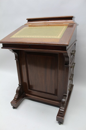 A LATE VICTORIAN MAHOGANY DAVENPORT DESK, having hinged compartment to back, tooled leather inset slope, drawers to column with brass handles, 55cm wide