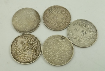 A COLLECTION OF FIVE CHINESE SILVER COINS, combined weight 134g.