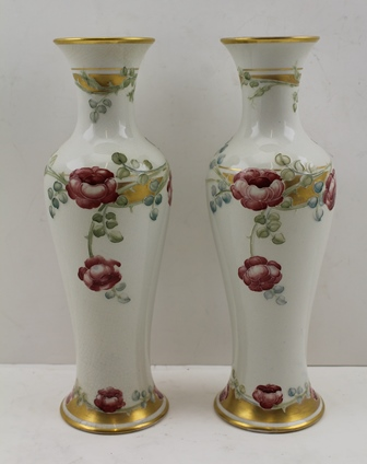 WILLIAM MOORCROFT (1872-1945) FOR JAMES MACINTYRE & CO. LTD. A PAIR OF ROSE GARLAND PATTERN VASES of baluster form with gilded rims, circa 1907, painted factory marks to bases, green painted signature and in red the number M2837/7, 25cm high