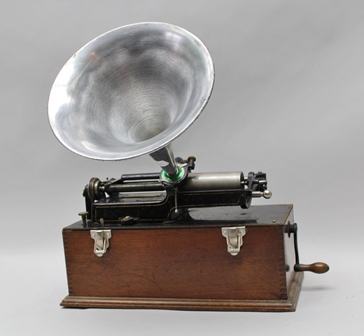 AN EDISON HOME PHONOGRAPH, cylinder playing, with aluminium horn in an oak veneer box, 39cm wide together with eighteen cylinders,
