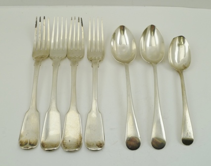 FOUR FIDDLE PATTERN SILVER TABLE FORKS, having various assay marks, together with THREE VARIOUS SILVER DESSERT SPOONS, total weight 440g.