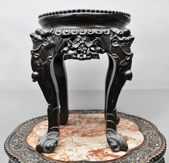 A JAPANESE CARVED HARDWOOD JARDINIERE STAND, the top inset with petal edge rouge marble panel, fitted undertier, 52cm diameter, together with ONE OTHER SMALLER STAND (2)
