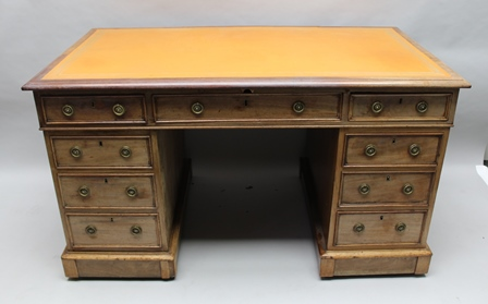 A 19TH CENTURY MAHOGANY TWIN PEDESTAL WRITING DESK fitted nine drawers with brass ring handles, tooled skiver inset, 137cm wide
