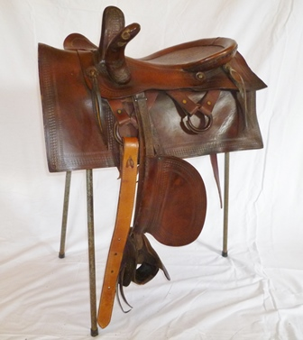 A GOODNIGHT WESTERN SIDE SADDLE circa 1900, full head 20 x 14 seat, with leaping head, complete with cinch, lariat and hobbles, medium fit