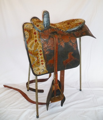 AN AMERICAN SIDE SADDLE, full head, carpet seat and safe, roller bar, stirrup and girth, highly decorative