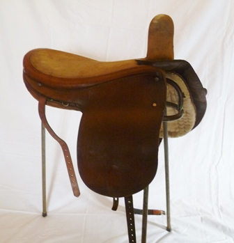 HARRIES OF SHREWSBURY 1910-1915 SIDE SADDLE, cut back head, 18 x 13 seat, eaved doeskin seat (missing leaping head), with C & W stamped stirrup fitting, narrow fit, suitable for Historical Costume classes