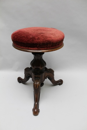 A MID 19TH CENTURY CARVED WOOD REVOLVING PIANO STOOL