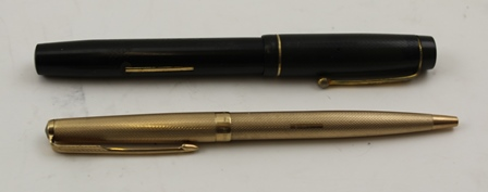 A 9CT GOLD CASED PARKER BALL-POINT PEN, together with a Stephens fountain pen with 14ct gold nib (2)