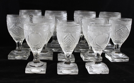 A SUITE OF CIRCA 1830 BIEDERMEIER WELL CUT GOBLETS comprising four red wine, four white wine and four water glasses and two champagnes, on faceted stems and square bases, 16cm high tallest