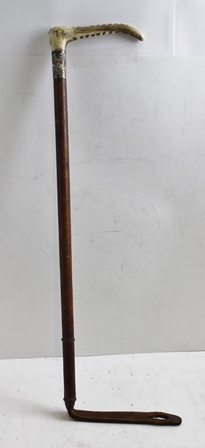 A LADYS STEEL LINED HUNTING WHIP by Zair, with antler grip, silver collar engraved with initial and leather shaft, together with a Silver 501 whip stock pin with Fox mask decoration 6.8cm long and a gold plated Tie Pin, 5cm long (3)
