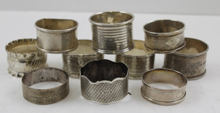 A COLLECTION OF TEN SILVER SERVIETTE RINGS, various assay hallmarks, combined weight 202g