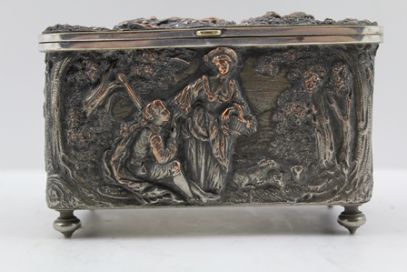 A 19TH CENTURY FRENCH SILVER PLATED CASKET with rural scenes in high relief to the hinged cover and sides in the round, 12.5cm wide