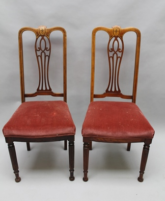 A SET OF EIGHT PROBABLY CONTINENTAL LATE 19TH/EARLY 20TH CENTURY HIGH BACK ART NOUVEAU DESIGN CHAIRS with fancy pierced central slat, with mixed wood stringing, having over stuffed seat pads, on turned reeded four legs and plain rear 105cm high