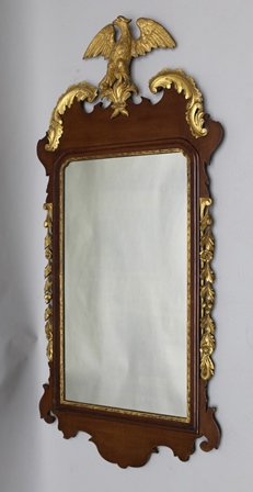 A 20TH CENTURY GEORGIAN DESIGN FRET WORK FRAMED PLAIN PLATE MIRROR with gilded eagle crest, with applied gilded scroll work and filet, 125cm total height