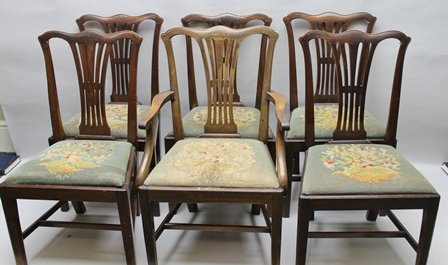 A SET OF SIX MAHOGANY GEORGIAN DESIGN DINING CHAIRS comprising; an open arm carver and five singles, each with shaped top rail, pierced splats, woolwork upholstered drop-in seat, on squared tapering supports with cross stretchers