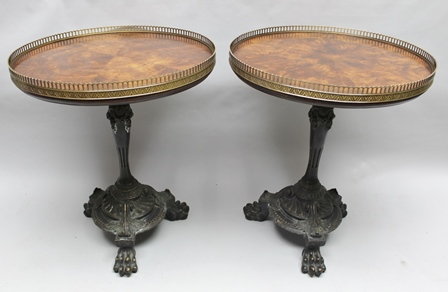 A PAIR OF THEODORE ALEXANDER DELIGHTS OF FRANCE GALLERY TOPPED SIDE TABLES based on the original at Althorp, each having a 56cm diameter mahogany veneered top, supported on cast metal base with a bronzed finish, supported on three lion paw feet.  62cm high to table top and each bearing the Spencer family crest to underside