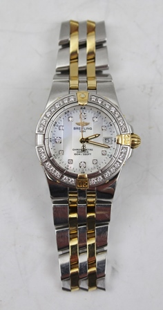 A LADYS BREITLING CHRONOMETER DIAMOND SET STAINLESS STEEL WRIST WATCH, bi-colour with mother of pearl dial and diamond baton markers, date aperture at 3 oclock, bi-colour bracelet strap, case no.B71340. 888093