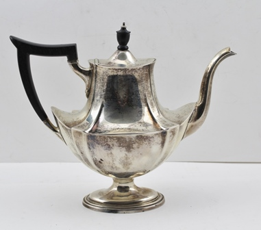 A STERLING SILVER COFFEE POT of Georgian design, waisted body, on oval platform base, stamped Sterling, weight (including non-silver handle and lid knop) 704g