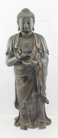 AN EARLY TO MID 19TH CENTURY CHINESE BRONZE SHAKYAMUNI STANDING BUDDHA, he holds in the palm of his left hand the pearl of wisdom, traces of gilding to robes, 81cm high (The Swastika symbol was originally an ancient religious Icon, symbol of divinity and spirituality in Eastern Religions)