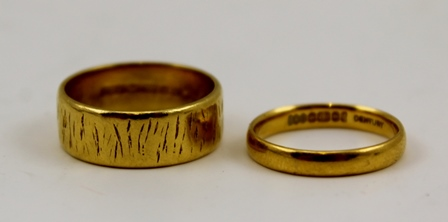 TWO 22CT GOLD WEDDING BANDS, one plain, the other bark effect (2) combined weight 8g