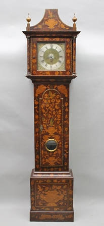 THOMAS SHERWOOD YARM AN EARLY 19TH CENTURY MARQUETRY LONGCASE CLOCK, the hood with pagoda shaped top, finials, column mounted glazed door, with inset linticle glass, overall marquetry of vases of flowers, birds, cornucopia, flowers, fitted square brass face, 11cm square, with cast spandrels, silvered chapter ring with Roman hours and Arabic minutes, with bell, 30 hour movement, 2.24m high