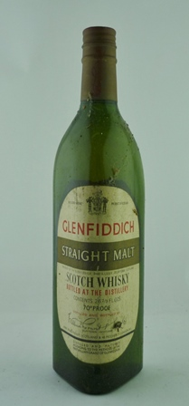 GLENFIDDICH STRAIGHT MALT WHISKY, 70 degrees proof, 1 x 26 2/3 fl.ozs (level at base of foil - very dusty but intact label)