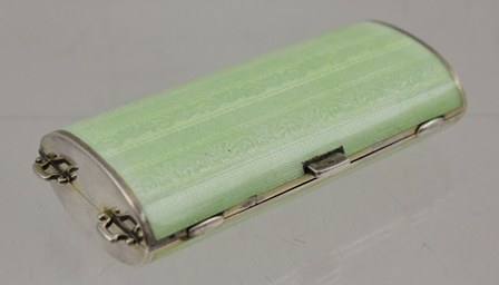 AN ART DECO NECESSAIRE, green guilloche enamel on silver, gilded interior of two compartments and bevel edge mirror