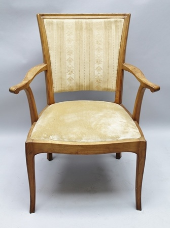 EDWARD BARNSLEY WORKSHOP A MID 20TH CENTURY BLONDE WOOD FRAMED ARMCHAIR, with upholstered back and drop in seat pad, supported on four plain, shaped legs.  Stamped to underside of rail, 92cm high