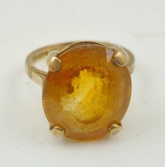 A 9CT GOLD LADYS DRESS RING set with an oval facet cut citrine, size M and half
