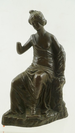A 16TH CENTURY EUROPEAN BRONZE SCULPTURE AFTER THE ANTIQUE, IN THE MANNER OF CONRAD MEIT. Woman scholar seated, her left foot upon a box, 14cm high