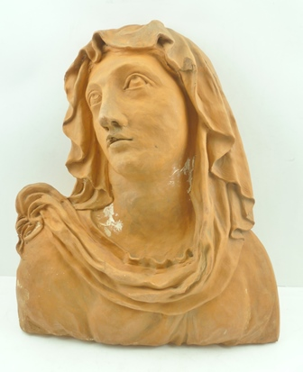 A NORTHERN EUROPEAN TERRACOTTA SCULPTURE OF OUR LADY OF SORROWS, considered to be 18th century, 42cm high (with alterations so can be wall mounting)
